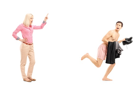 is embarrassed: Full length portrait of a woman shouting at a ]guy running away, isolated on white background Stock Photo
