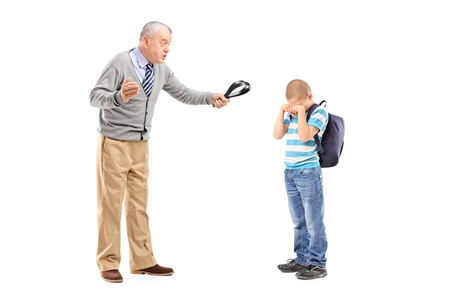 crying boy: Full length portrait of an angry grandfather holding a belt and threatening on his nephew isolated on white background