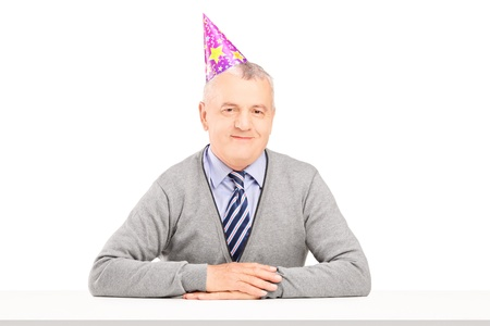 party hats: Happy mature gentleman with party hat isolated against white background