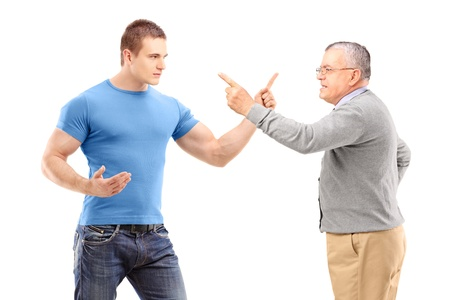 A guy and mature man arguing isolated on white background photo