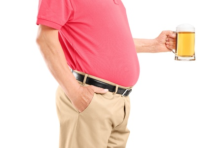 excess: An old man with belly holding a beer glass isolated on white background