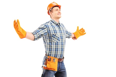 Happy manual worker with helmet spreading arms, isolated on white background photo