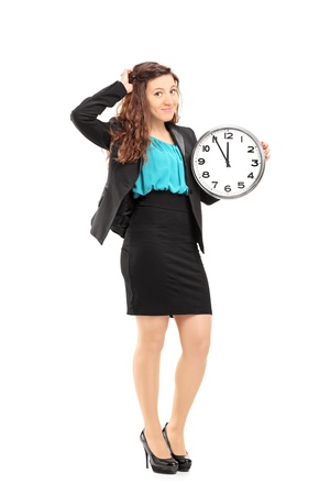 Full length portrait of a young smiling businesswoman holding a wall clock isolated on white background photo