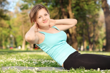 excercise: Young female exercising in a park Stock Photo