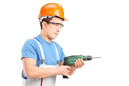 driller: A manual worker with helmet using a drill tool isolated on white background Stock Photo