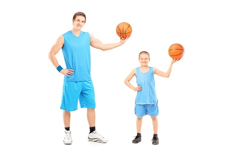 Full length portrait of a basketball players posing isolated on white background photo