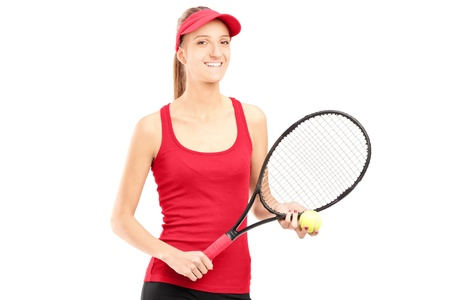A smiling female holding a tennis racket and a ball isolated on white background photo