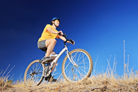 A young male riding a mountain bike outdoors Stock Photo - 19406287