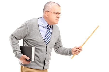 An angry mature teacher holding a wand and gesturing isolated against white photo