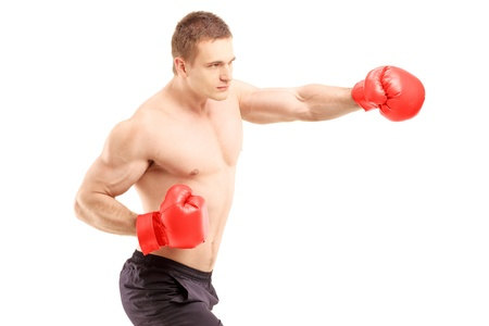 kick boxer: An athlete with boxing gloves, isolated on white background