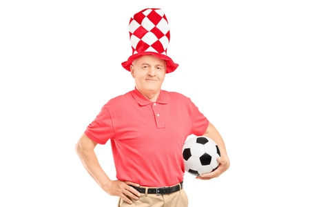 soccer fan: A middle aged male fan with hat holding a soccer ball isolated on white background Stock Photo