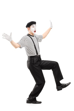 dance pose: Full length portrait of a surpised mime artist gesturing with hands, isolated on white background Stock Photo