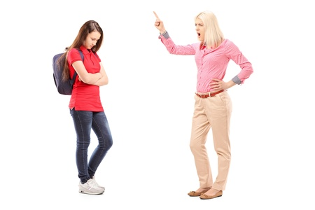 unpleasant: Full length portrait of an angry mother shouting at her daughter isolated on white background
