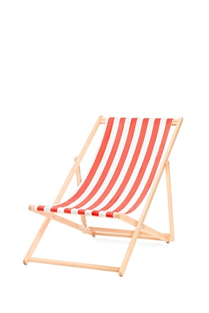 Sun lounger in stripes, isolated on white background photo