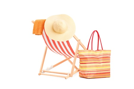 deckchair: Sun lounger with orange stripes and summer accessories, isolated on white background Stock Photo