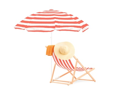 Sun lounger with stripes and umbrella, isolated on white background photo