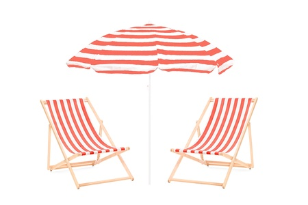 chairs: Two beach sun loungers and an umbrella, isolated on white background Stock Photo