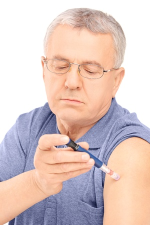 hormone  male: Middle aged man injecting insulin in his arm, isolated on white background