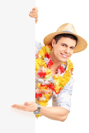 Smiling man in traditional costume gesturing with his hand on a blank panel isolated on white background photo