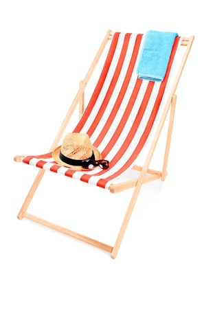 sunbed: Studio shot of a sun lounger with towel, hat and sunglasses isolated on white background