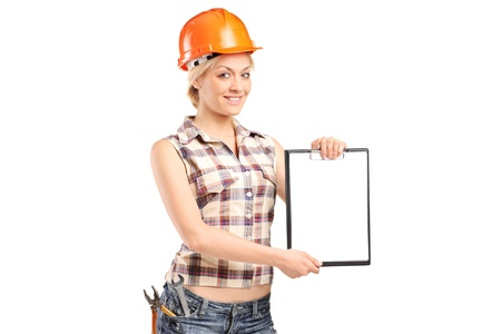 female construction worker: Female worker showing a blank clipboard isolated against white background Stock Photo
