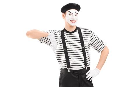 pantomima: Hombre mimo posando aislados sobre fondo blanco Foto de archivo