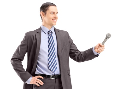 Professional male reporter holding a microphone, isolated on white background photo