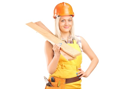Smiling female carpenter with helmet holding sills isolated on white background photo