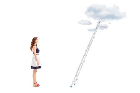 reachability: Full length portrait of a young female standing in front of a ladder with cloud and looking, isolated on white background