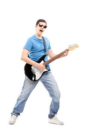 Full length portrait of a male musician playing an electric guitar, isolated on white background photo