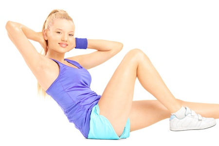 Blond female exercising abs on floor, isolated on white background Stock Photo - 19971894