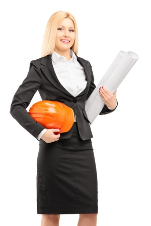 Female architect in black suit holding a helmet and a blueprint isolated against white background photo