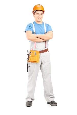 Full length portrait of a confident repairman in a uniform, isolated on white background photo