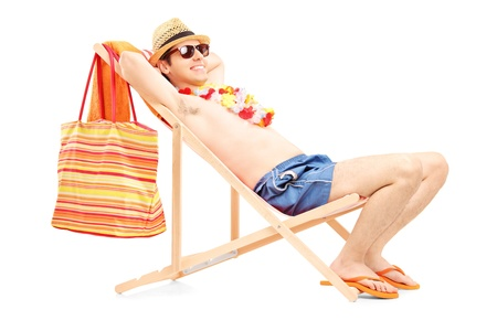 sunbed: Full length portrait of a man enjoying on a sun lounger, isolated on white background