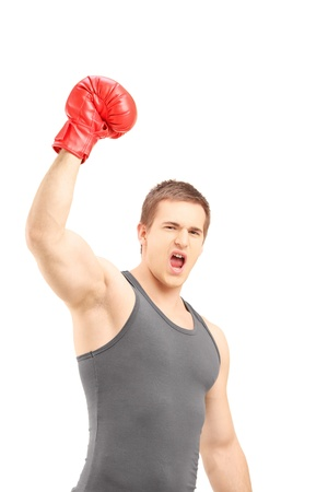 Happy male boxer wearing red boxing gloves and gesturing triumph isolated on white background photo