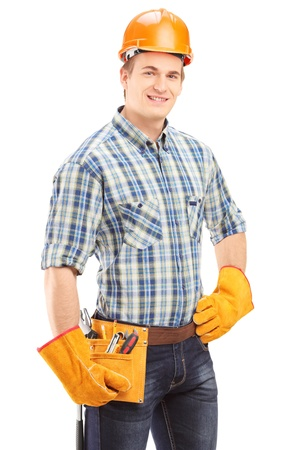 Confident and smiling manual worker with helmet looking at camera isolated on white background photo