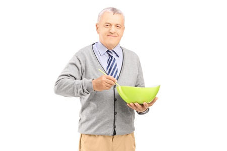 Smiling gentleman holding a pot and a spoon, prepairing meal isolated on white background  photo