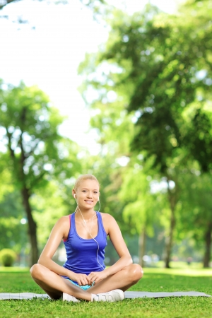 excercise: Smiling woman exercising yoga in a park