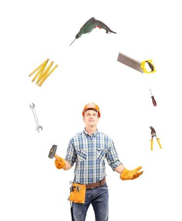 the hammer: Malabares Trabajador manual con herramientas, aislados en fondo blanco Foto de archivo