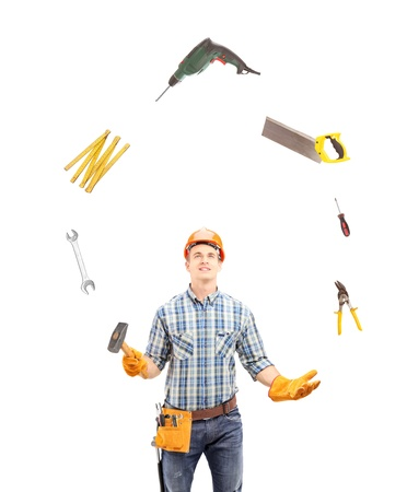Manual worker juggling with tools, isolated on white background