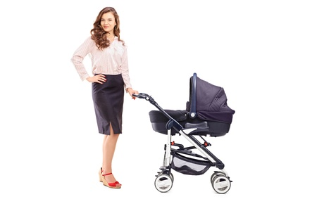 Full length portrait of a mother with a stroller, isolated on white background photo