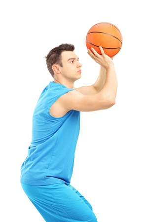 Basketball player about to score a point isolated against white background photo