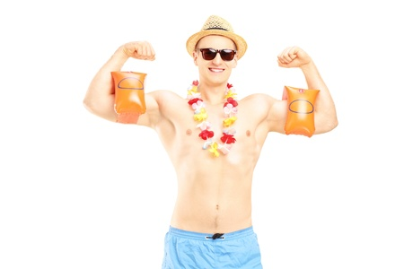 arm muscles: Guy in a swimsuit with swimming arm bands showing his muscles, isolated on white background