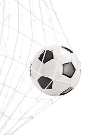 kick ball: Soccer ball in a goal net isolated on white background Stock Photo