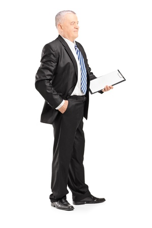 mature businessman: Full length portrait of a mature businessman posing with clipboard isolated on white background Stock Photo