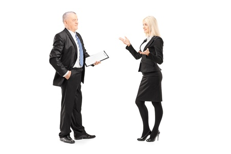 Full length portrait of a businesswoman explaining an idea to her boss isolated on white background photo