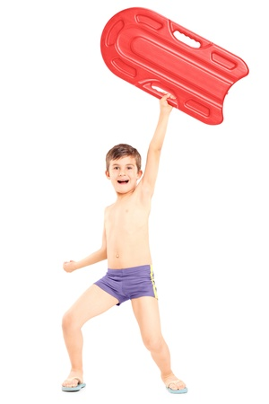 naked child: Full length portrait of a boy holding a swimming float and gesturing happiness, isolated on white background