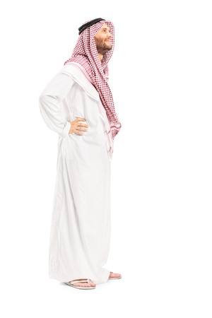 Full length portrait of a male arab person standing isolated on white background photo