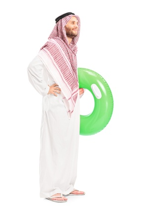 headcloth: Full length portrait of a male arab person holding a swimming ring isolated on white background