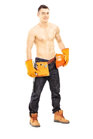 Full length portrait of a shirtless muscular male construction worker isolated on white background photo